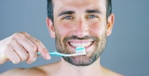 Man Smiling With Toothbrush