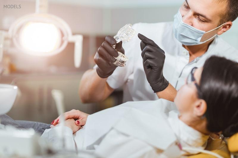 Woman getting a dental treatment during COVID.